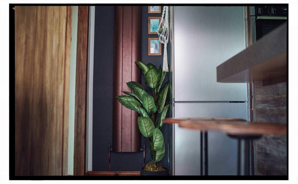 hammer beaten bronze aluminium upright radiator in our renovated kitchen