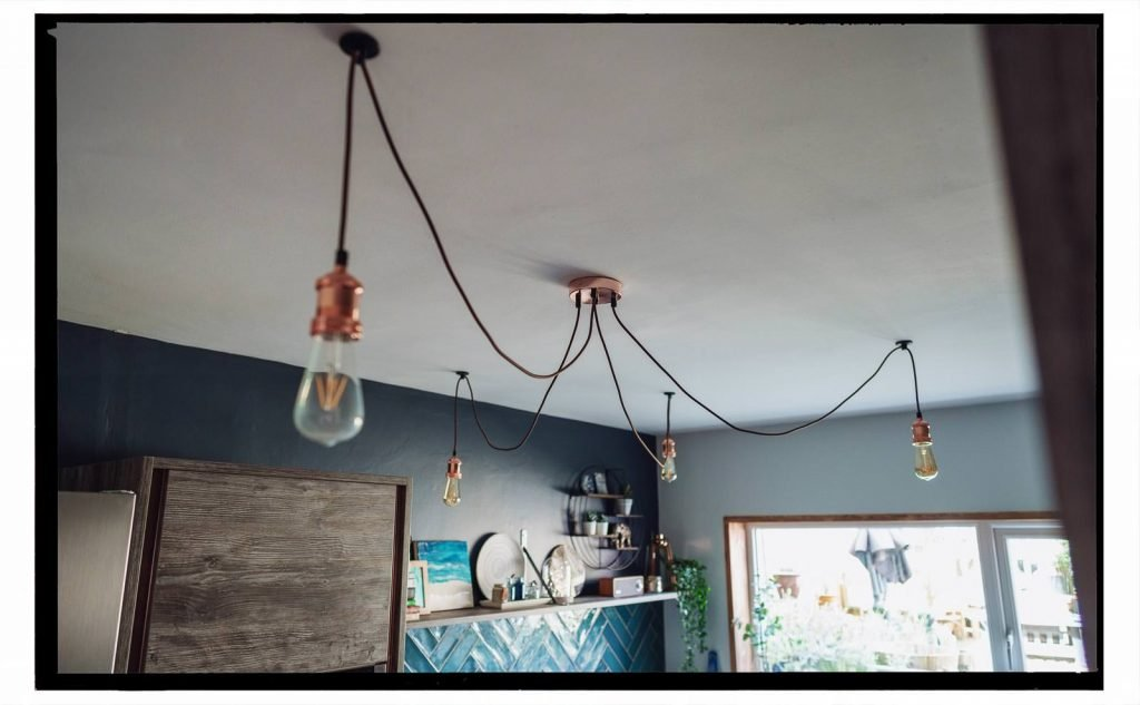 Industrial lighting in our renovated kitchen