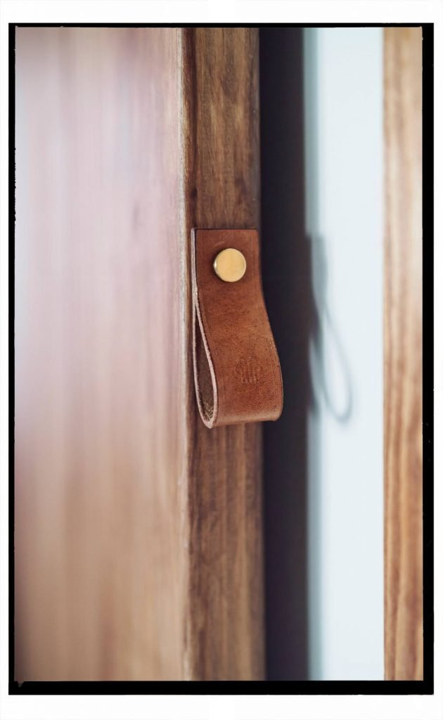 Leather door pull in our renovated kitchen